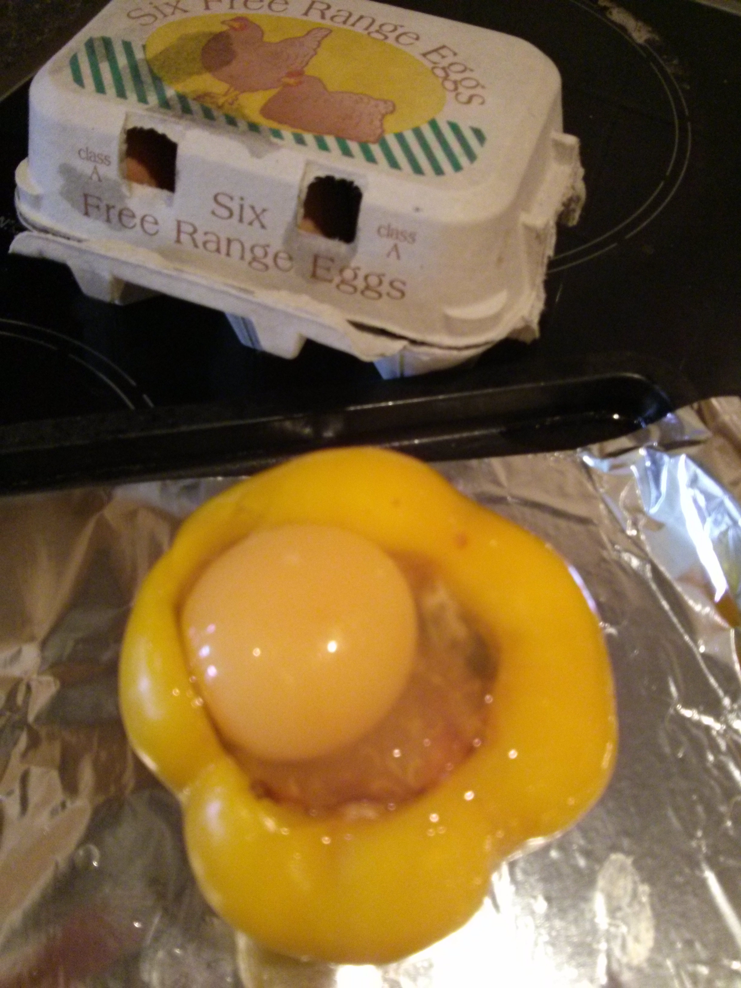 Crack egg into peppers